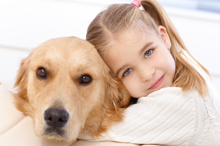 Image of a girl with a puppy
